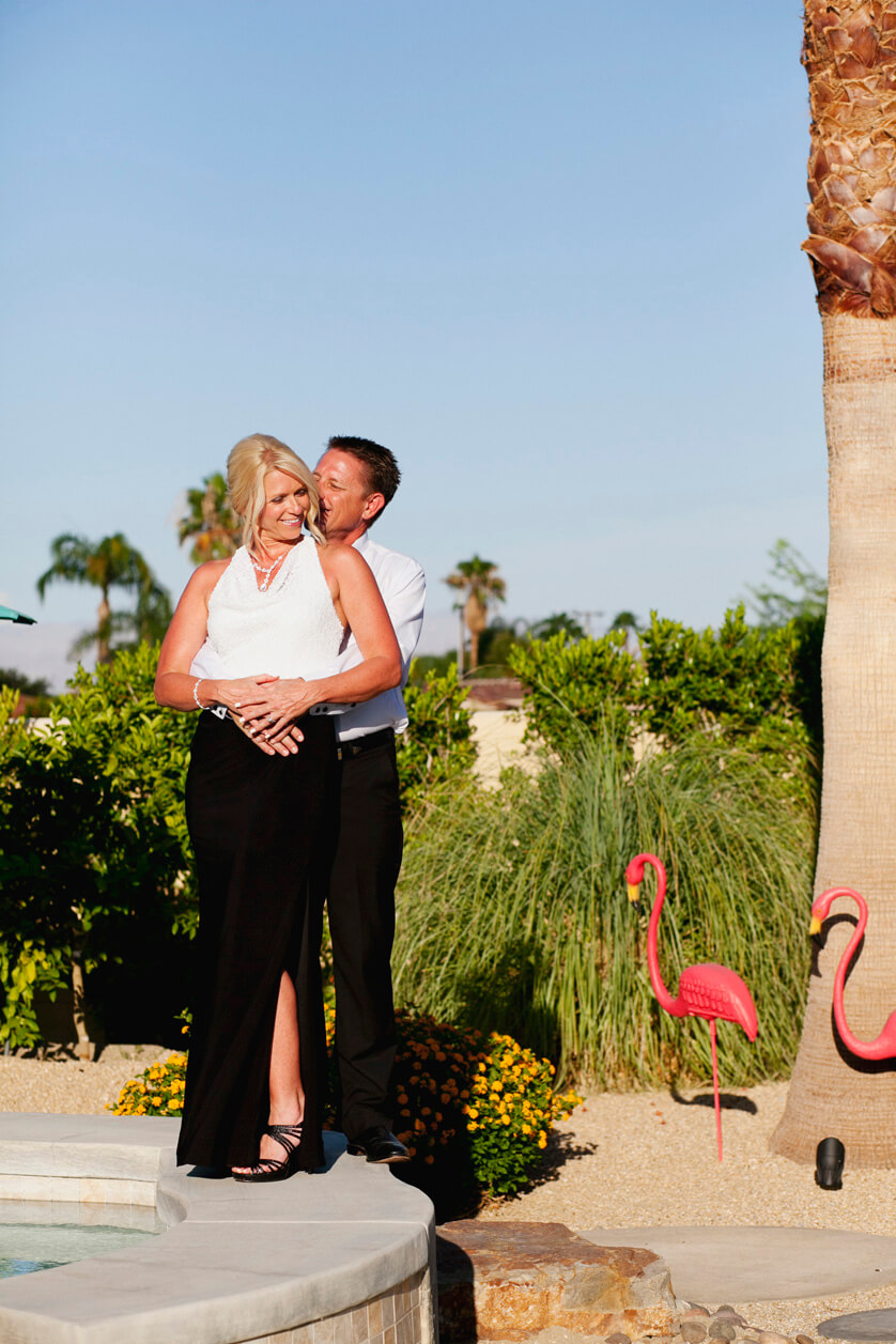 Palm Springs photographer, portrait of bride and groom embracing the full desert sun.