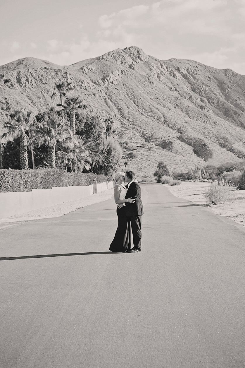 Fine art wedding photography Palm Springs California. Classic portrait in Black and White against start desert mountains
