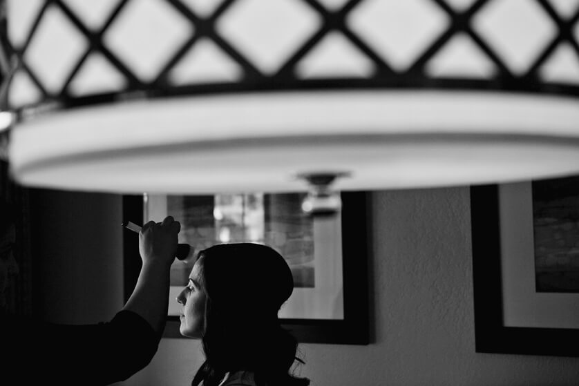 Wedding photograph Bride getting hair and makeup Black and white artistic