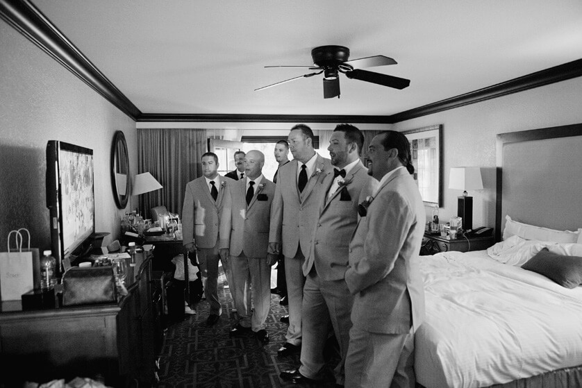 Groom and groomsmen check football scores