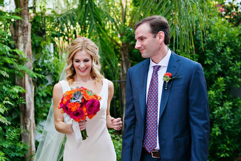 Bride admires her bouquet