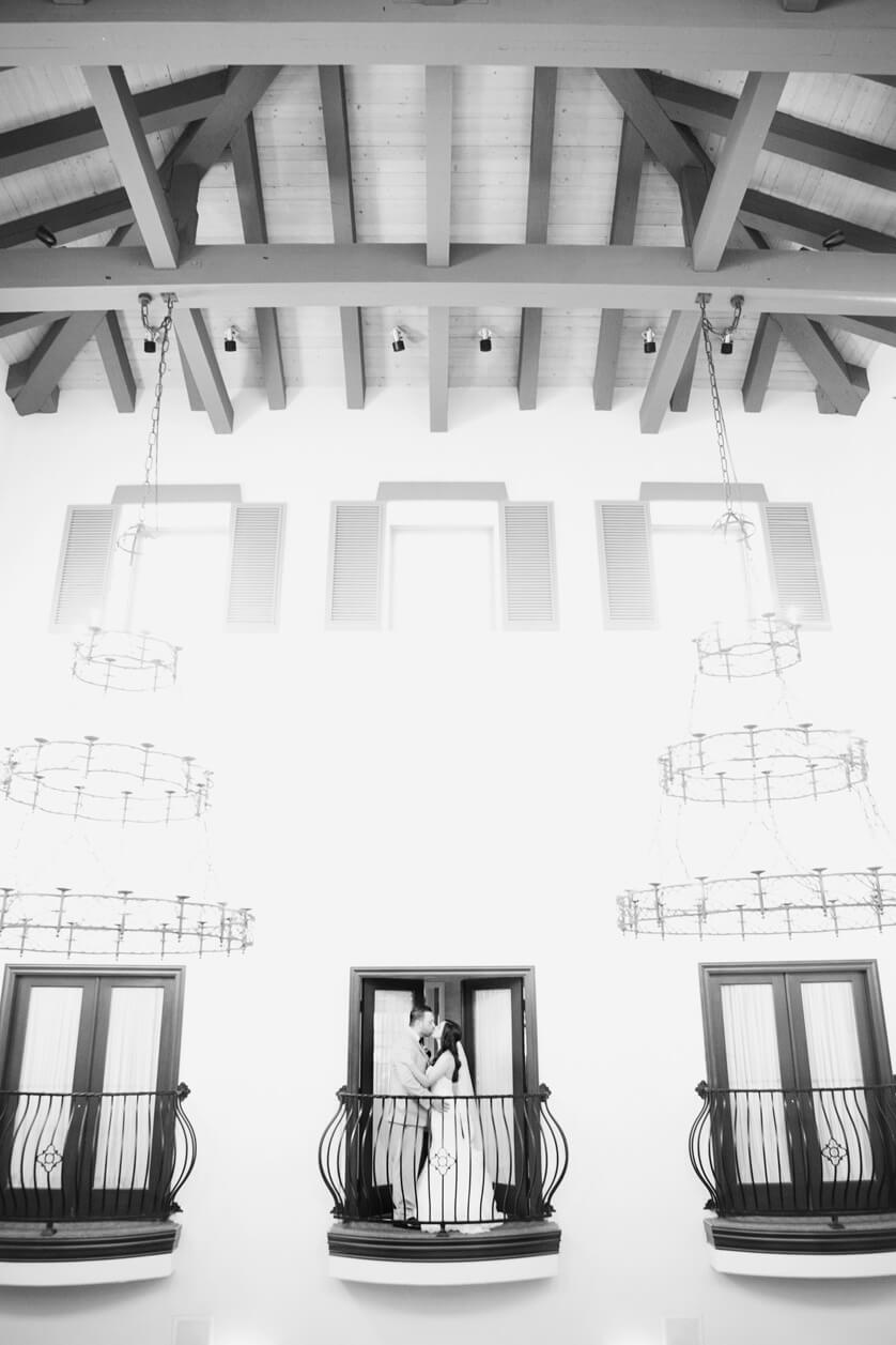 Dramatic balcony portrait of bride and groom