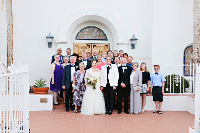 Family poses on the front steps of the church