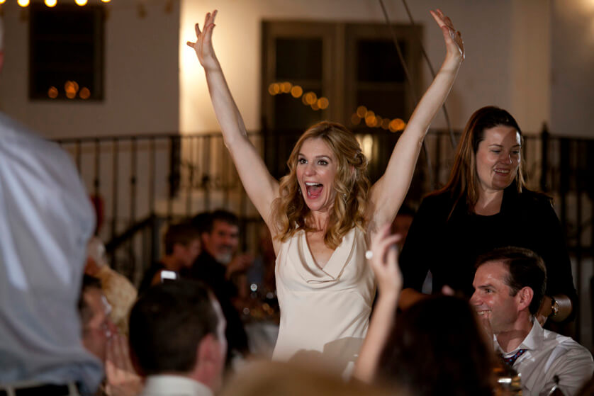 Bride celebrates as her college football team wins