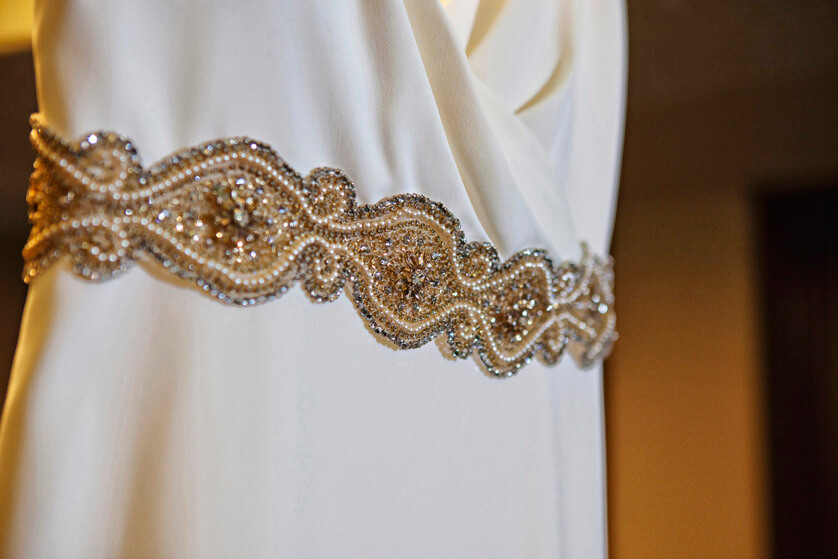 Beaded belt detail on wedding dress