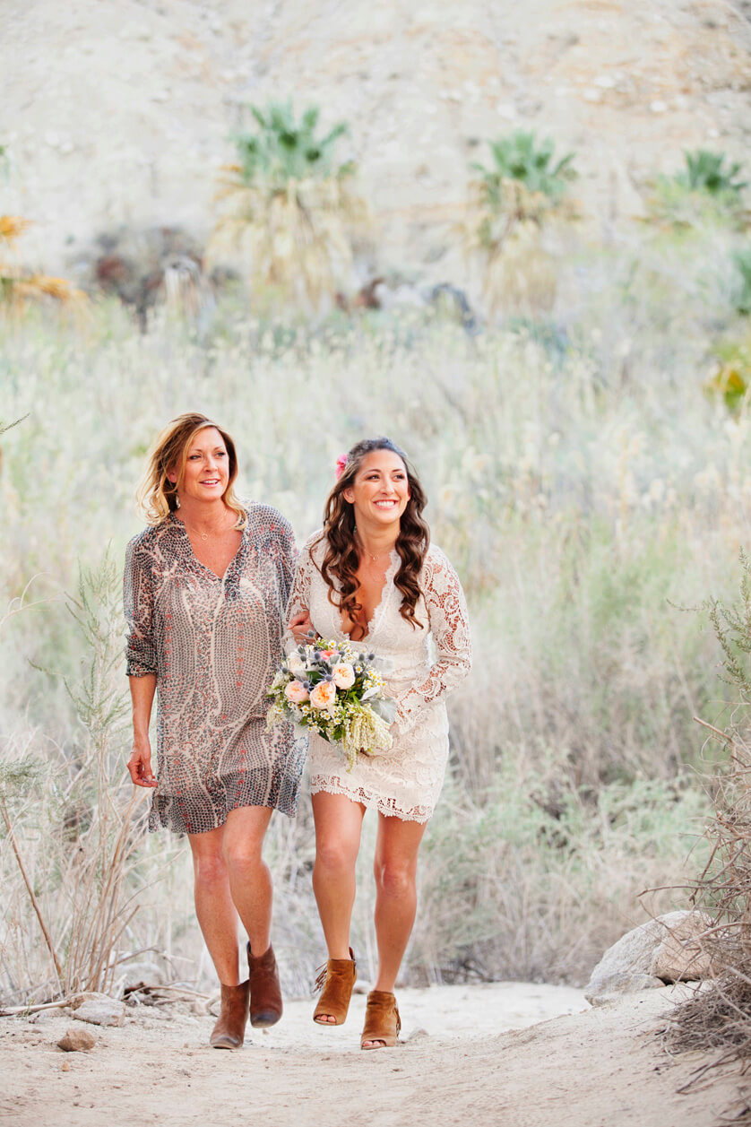 Bride is walked down the aisle by her mom a this elopement