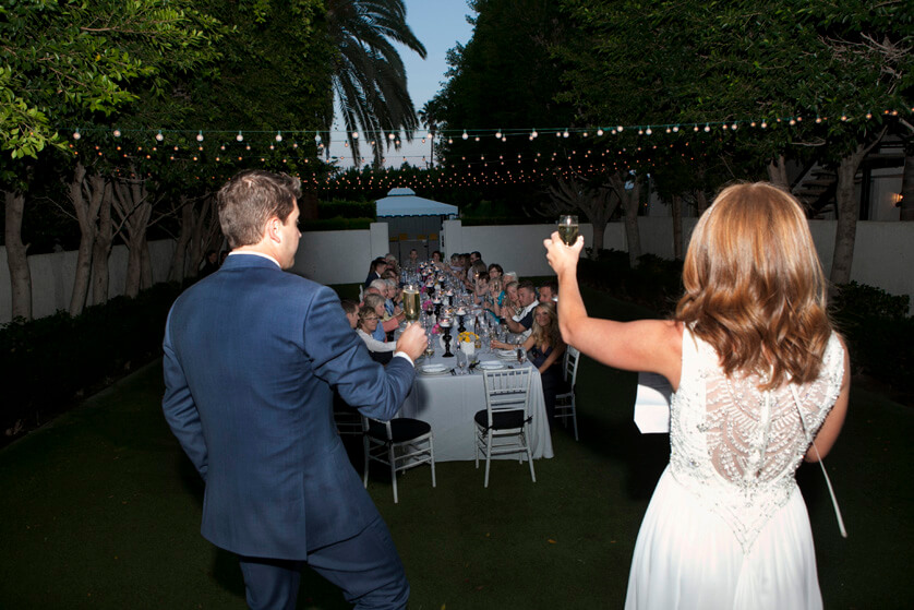 Bride and groom toast friends Palm Springs Avalon Wedding