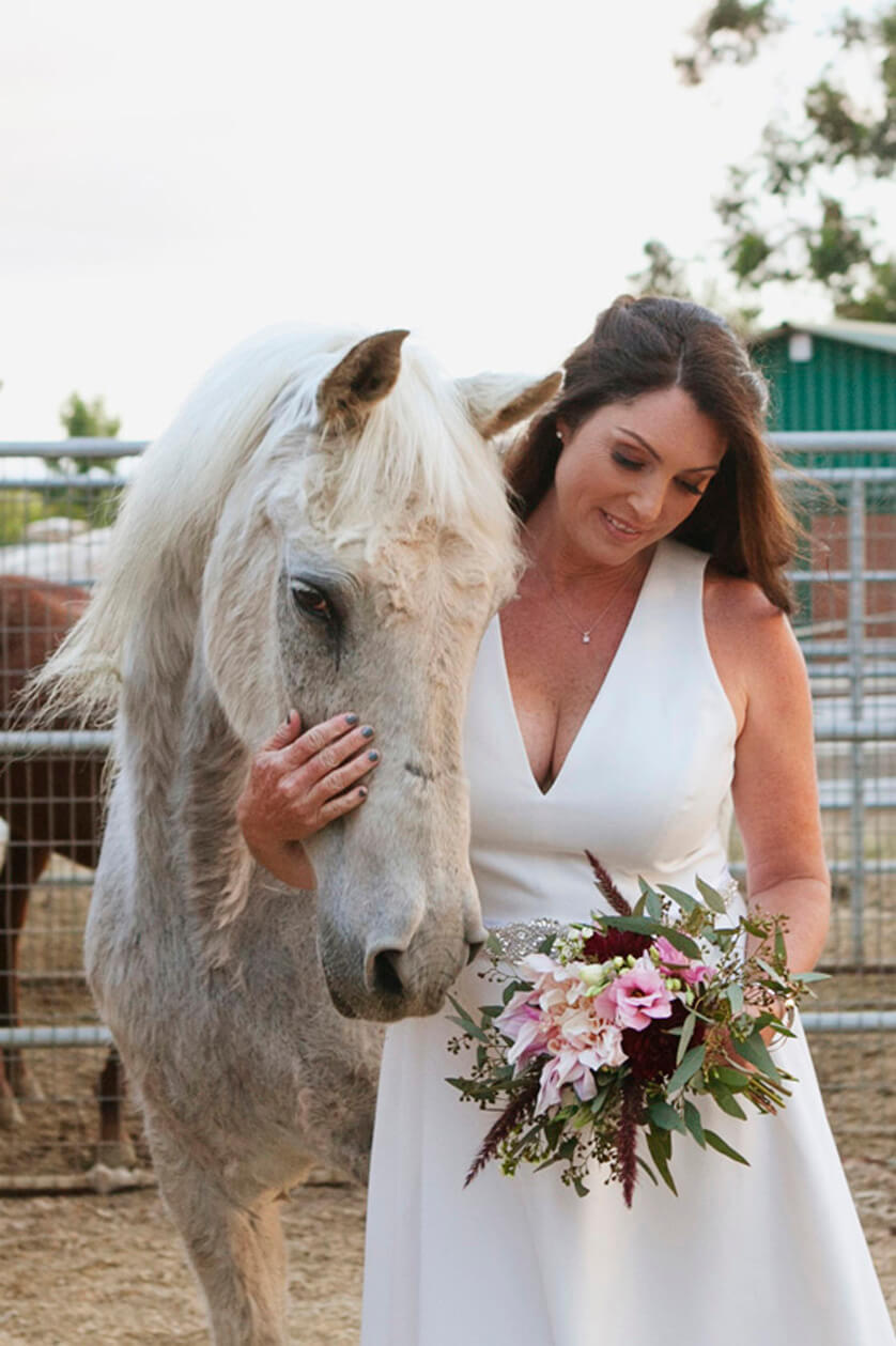 A lovely portrait of the bride with one of her horses