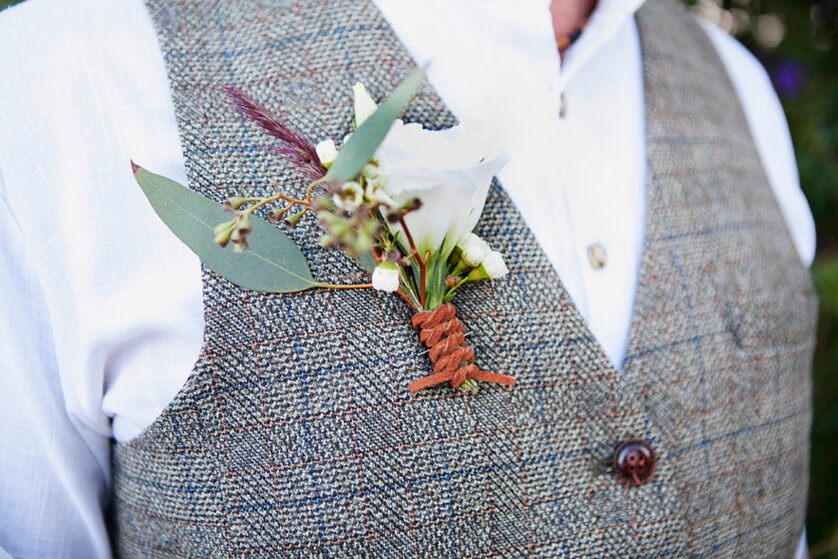 The grooms boutonniere featuring simple flowers