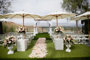Ceremony site at Ritz Carlton, Rancho Mirage. Rose petals in pinks and white decorate the aisle