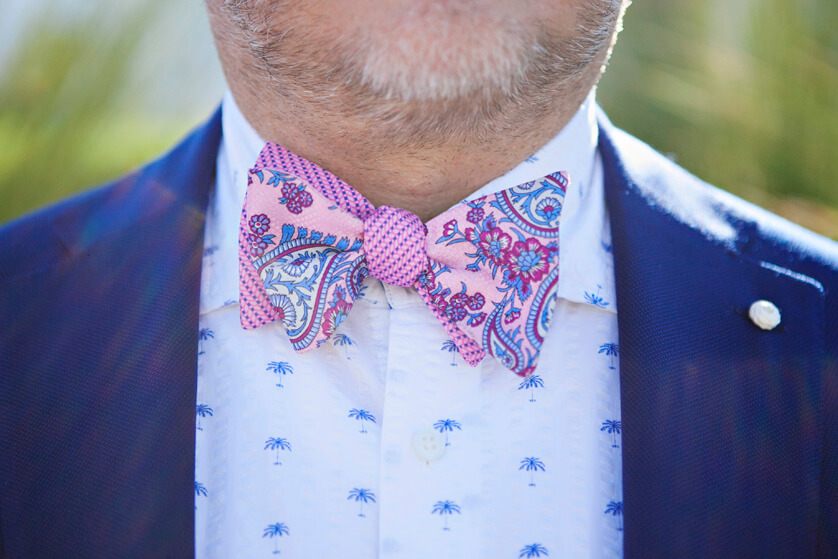 Detail of the grooms fun pink bow tie