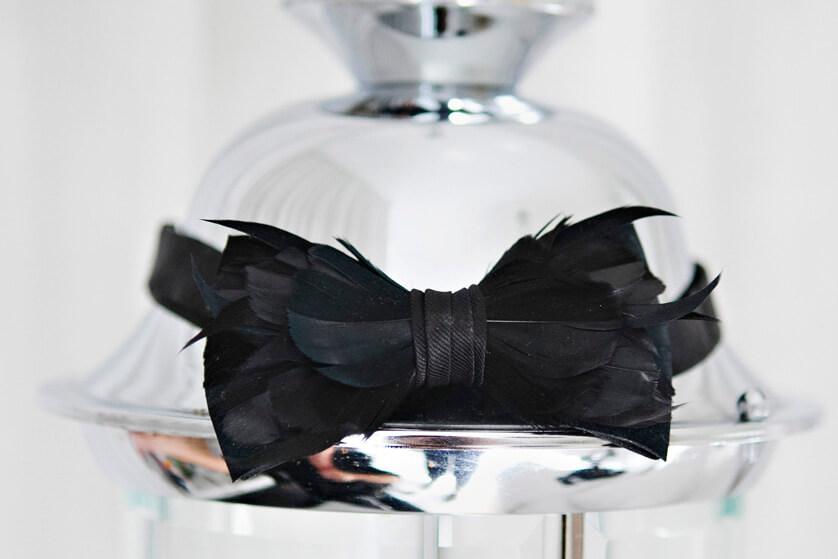 The grooms bowtie made out of feathers