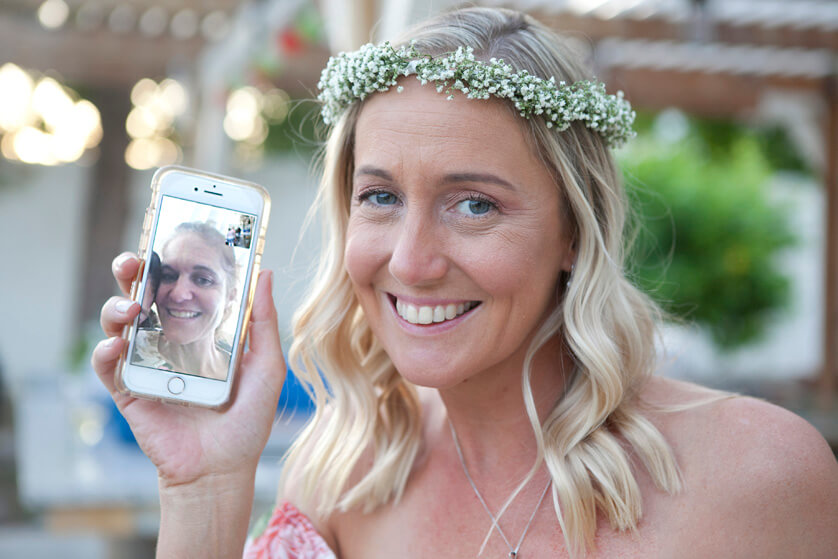 Bride chats with her sister in Australia